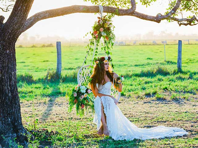 bride in a boho chair at a whitsundays wedding shoot
